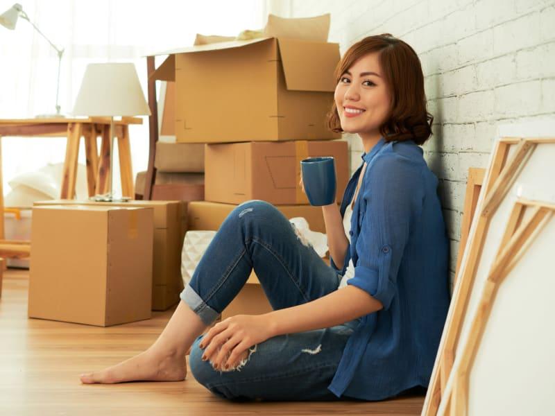 A woman packing near 603 Storage - Raymond in Raymond, New Hampshire