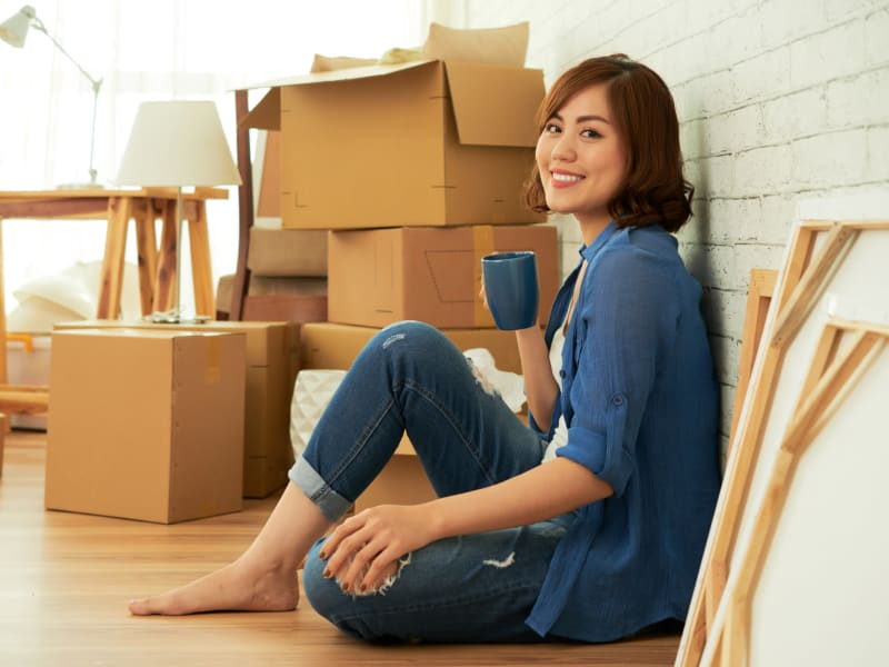 A woman packing near 603 Storage - Hudson in Hudson, New Hampshire