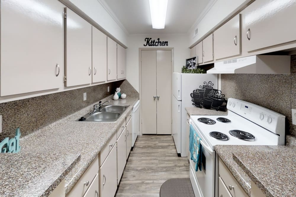 Kitchen at Falls of Maplewood Apartments in Houston, Texas