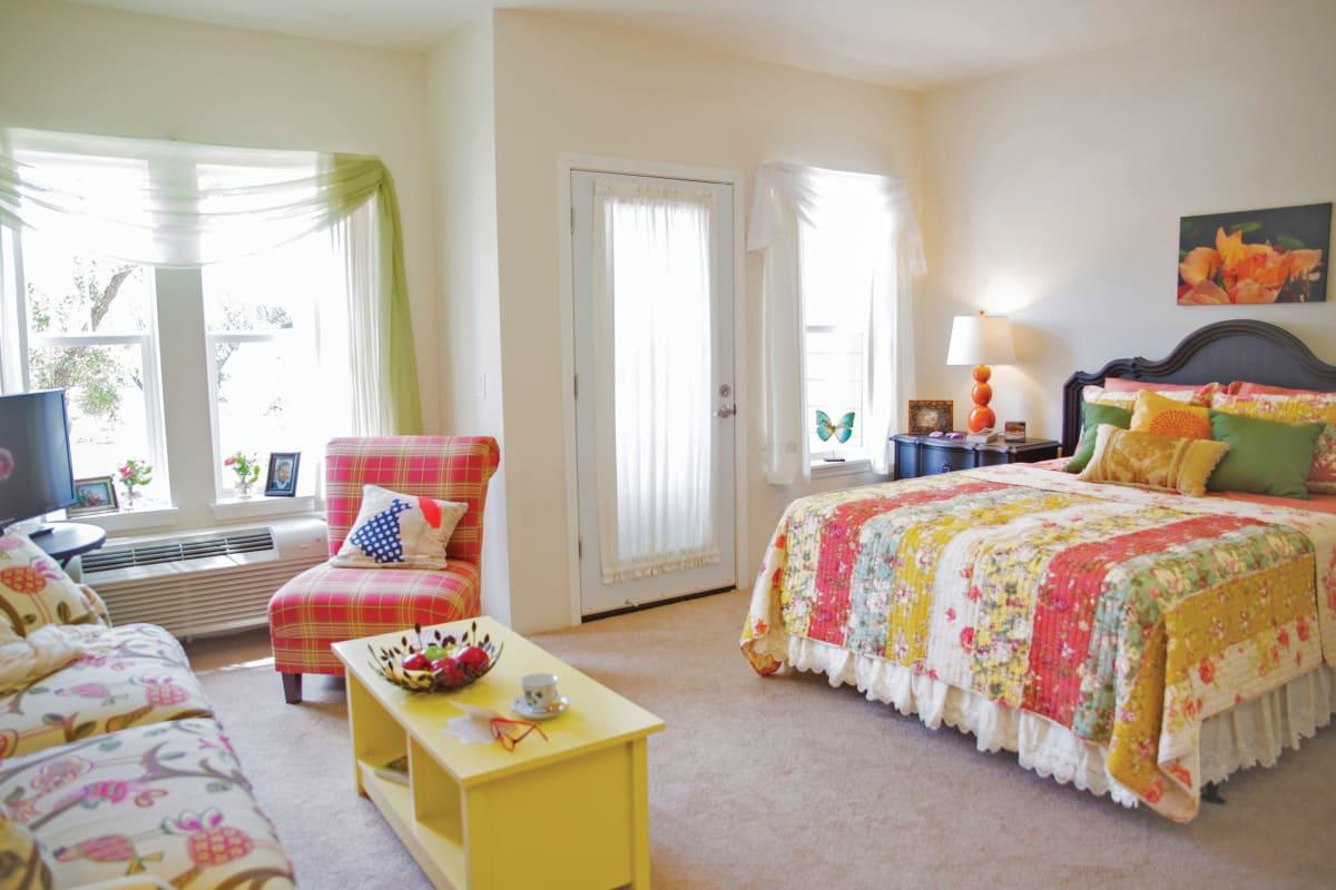 Apartment kitchen and living room at Estrella Estates Gracious Retirement Living in Goodyear, Arizona