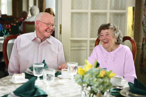 Residents happily dining together at Terrace Communities