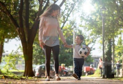 Resident mom walking her son to school near Santana Ridge in Denver, Colorado