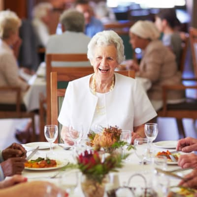 A woman enjoying the dining at Westminster Memory Care in Lexington, South Carolina