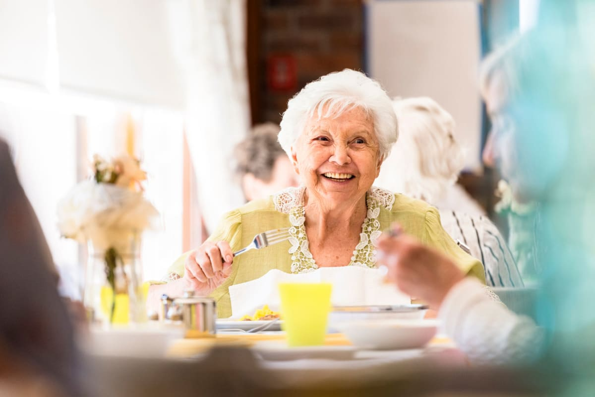 A woman with a gourmet lunch at Broadwell Senior Living in Kearney, Nebraska