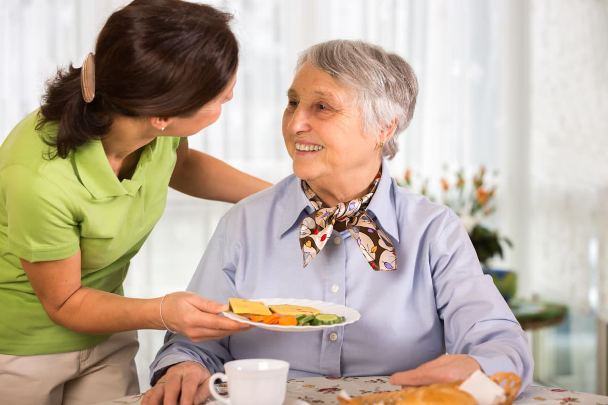 A woman enjoying a meal at Broadwell Senior Living in Kearney, Nebraska