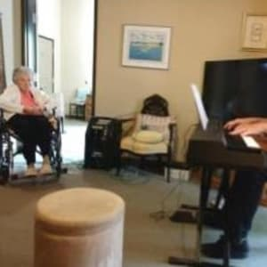 Resident Marge receives a personal concert for her Dare to Dream event at Milestone Senior Living in Eagle River, Wisconsin.
