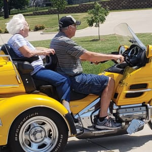 Resident Ida riding on a motorcycle near Emery Place in Robins, Iowa.