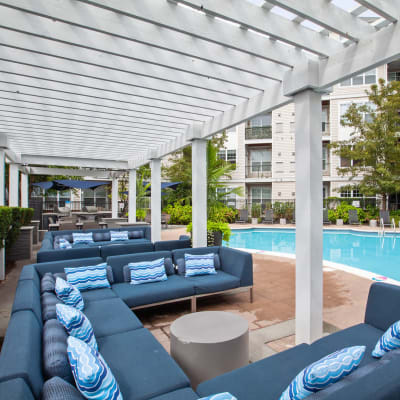 Massive lounge areas right next to the pool where you can relax and enjoy the sun at Sofi Lyndhurst in Lyndhurst, New Jersey