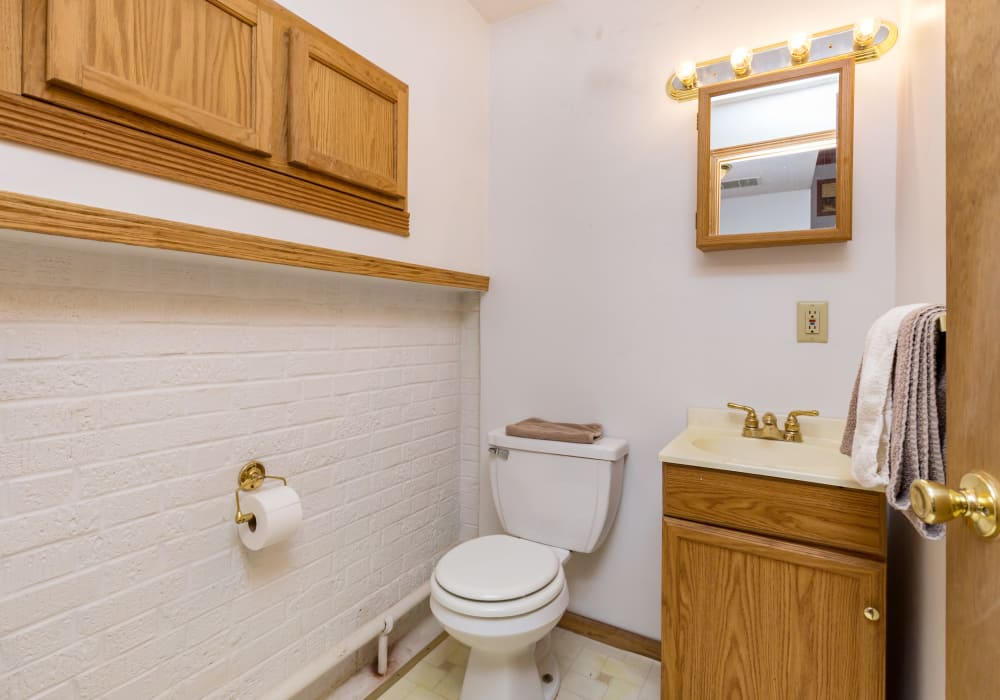 Bathroom with cabinet storage at Concord & Castle in Des Moines, Iowa