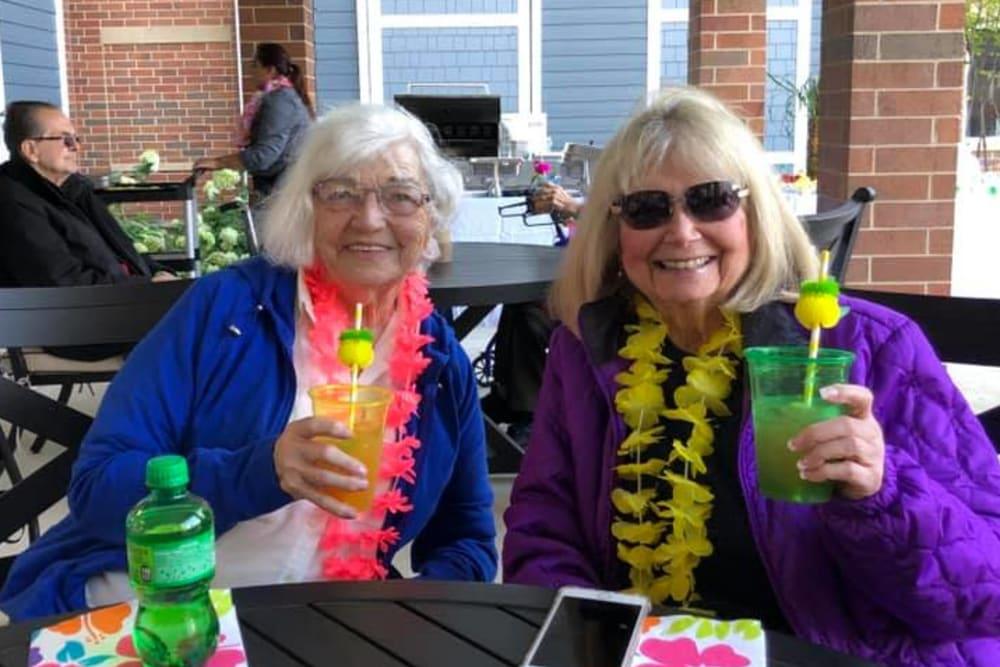 two residents enjoying drinks outside