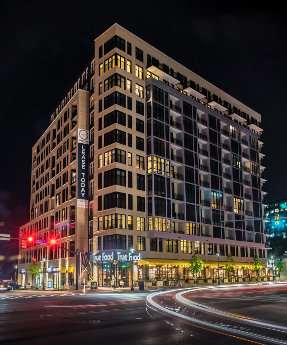 Beautiful street view at night of Solaire 7077 Woodmont in Bethesda, Maryland