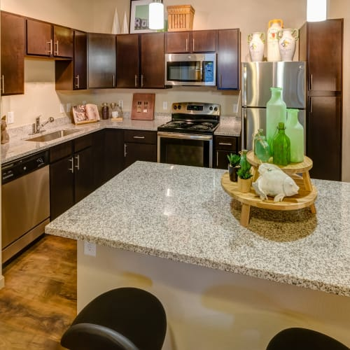 Gourmet kitchen with an island and granite countertops in a model home at Granite 550 in Casper, Wyoming