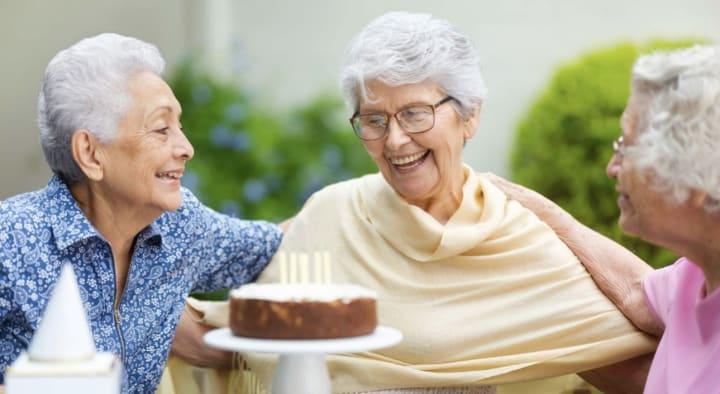 Senior woman celebrating birthday with friends