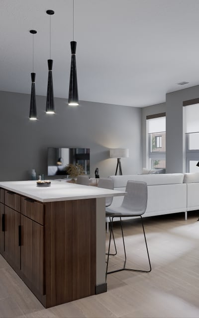 Gorgeous kitchen with pendent lighting at Solana Stapleton Apartments in Denver, Colorado