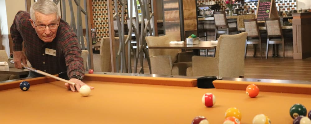 Resident playing pool at The Springs at Bozeman in Bozeman, Montana
