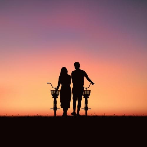 Resident couple enjoying the sunset at Portside Ventura Harbor in Ventura, California