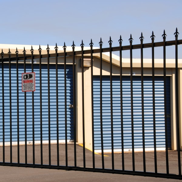 Outdoor storage units behind a secure fence at Big E Self Storage in Stockton, California
