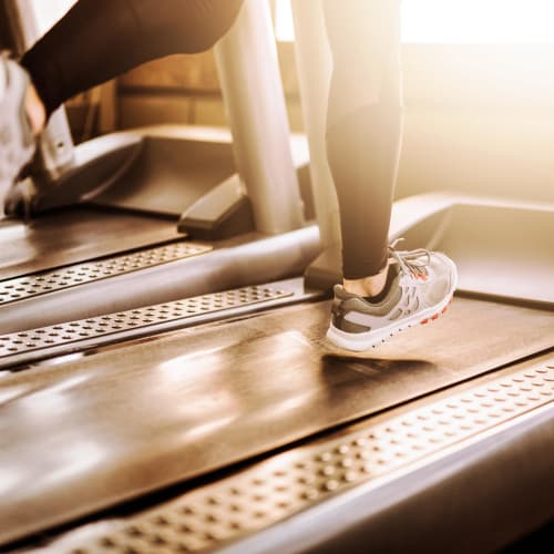 Resident running on the treadmill at Brookside Apartments in Gresham, Oregon