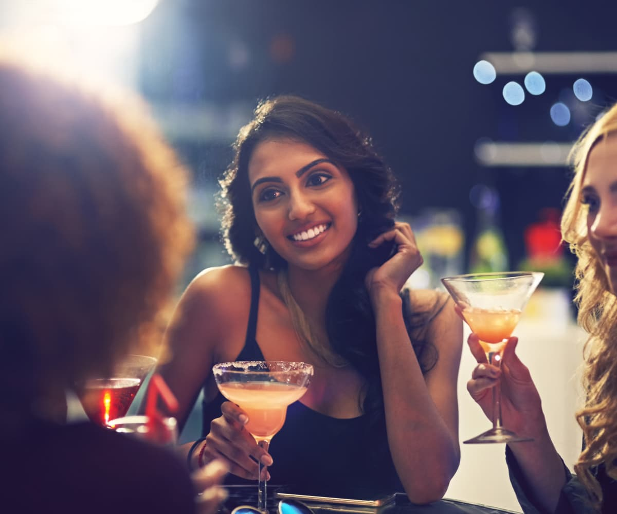 Residents out enjoying a drink together near Sugarberry Apartments in Tulsa, Oklahoma