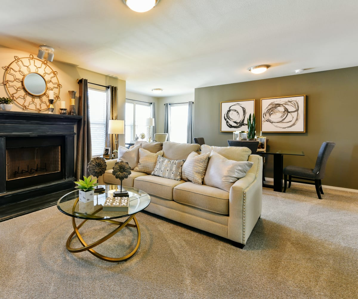 Bright living room at Cottages at Abbey Glen Apartments in Lubbock, Texas