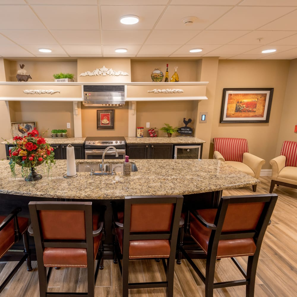 Self-service bistro  with island seating at Inspired Living Royal Palm Beach in Royal Palm Beach, Florida