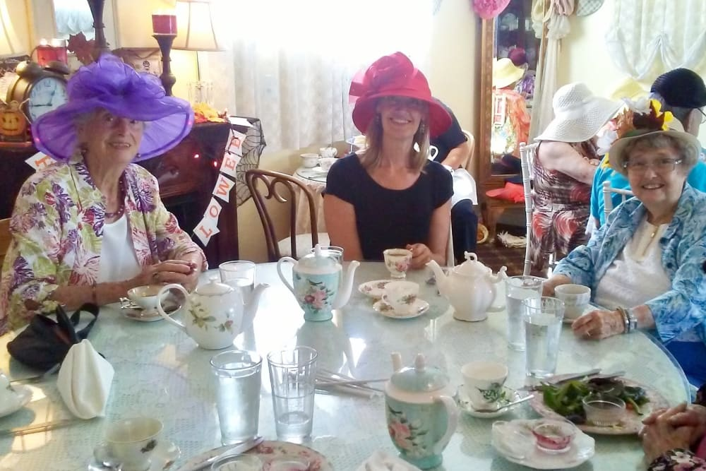 Residents and friends at a tea party hosted at Merrill Gardens at Huntington Beach, CA