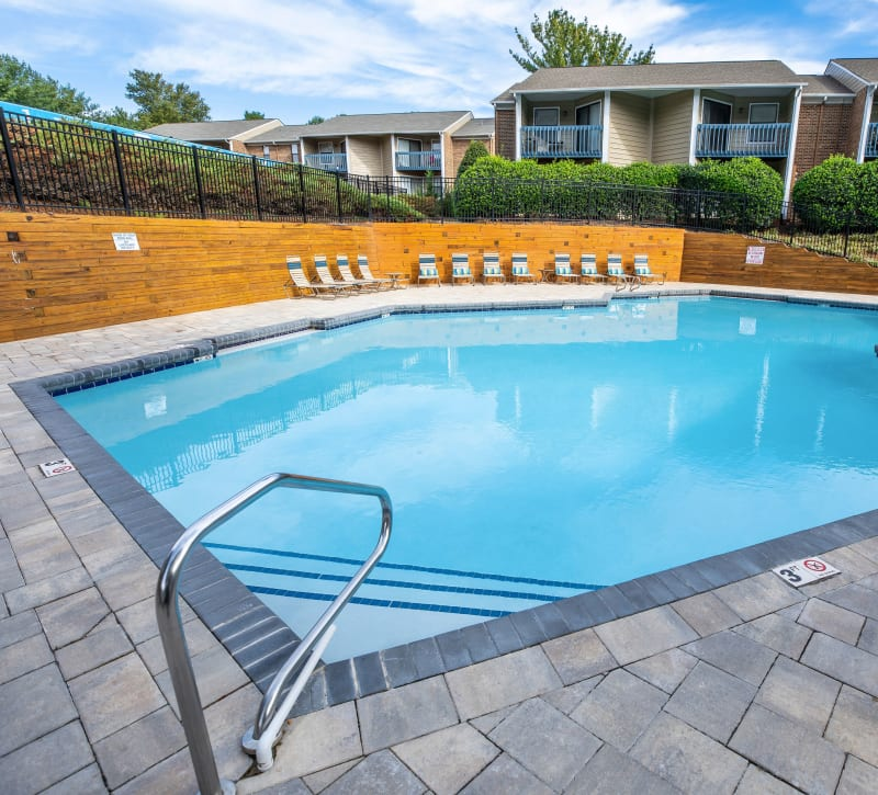A large swimming pool with a beautiful sundeck at Mill Creek Flats in Winston Salem, North Carolina
