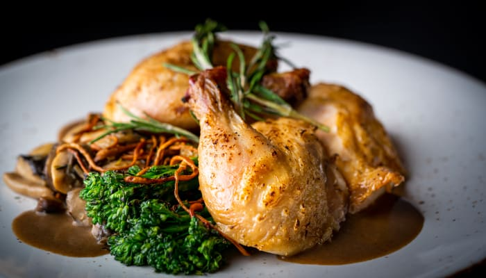 Roasted chicken and fresh vegetable dish at The Springs at Greer Gardens in Eugene, Oregon
