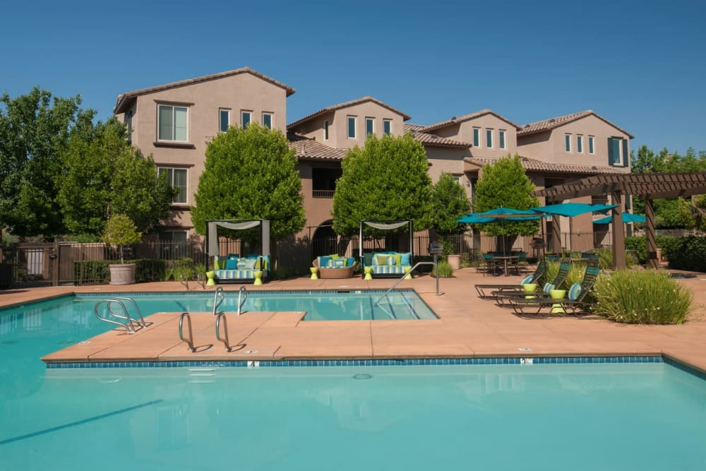 Poolside spa with a gazebo for shade at Venu at Galleria Condominium Rentals in Roseville, California