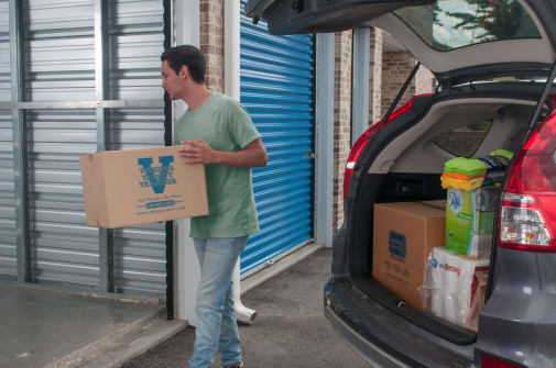 Customer loading up his new storage unit at Virginia Varsity Storage in Salem, Virginia