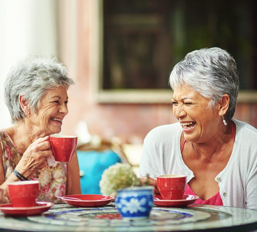 Resident sharing tea at MacArthur Hills in Irving, Texas