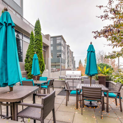 Terrace with barbecue area and gas grills at Verse Seattle in Seattle, Washington