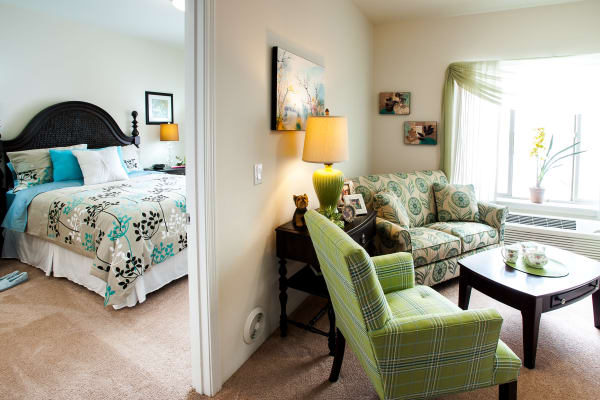 Living room and bedroom at Fairview Estates Gracious Retirement Living in Hopkinton, Massachusetts