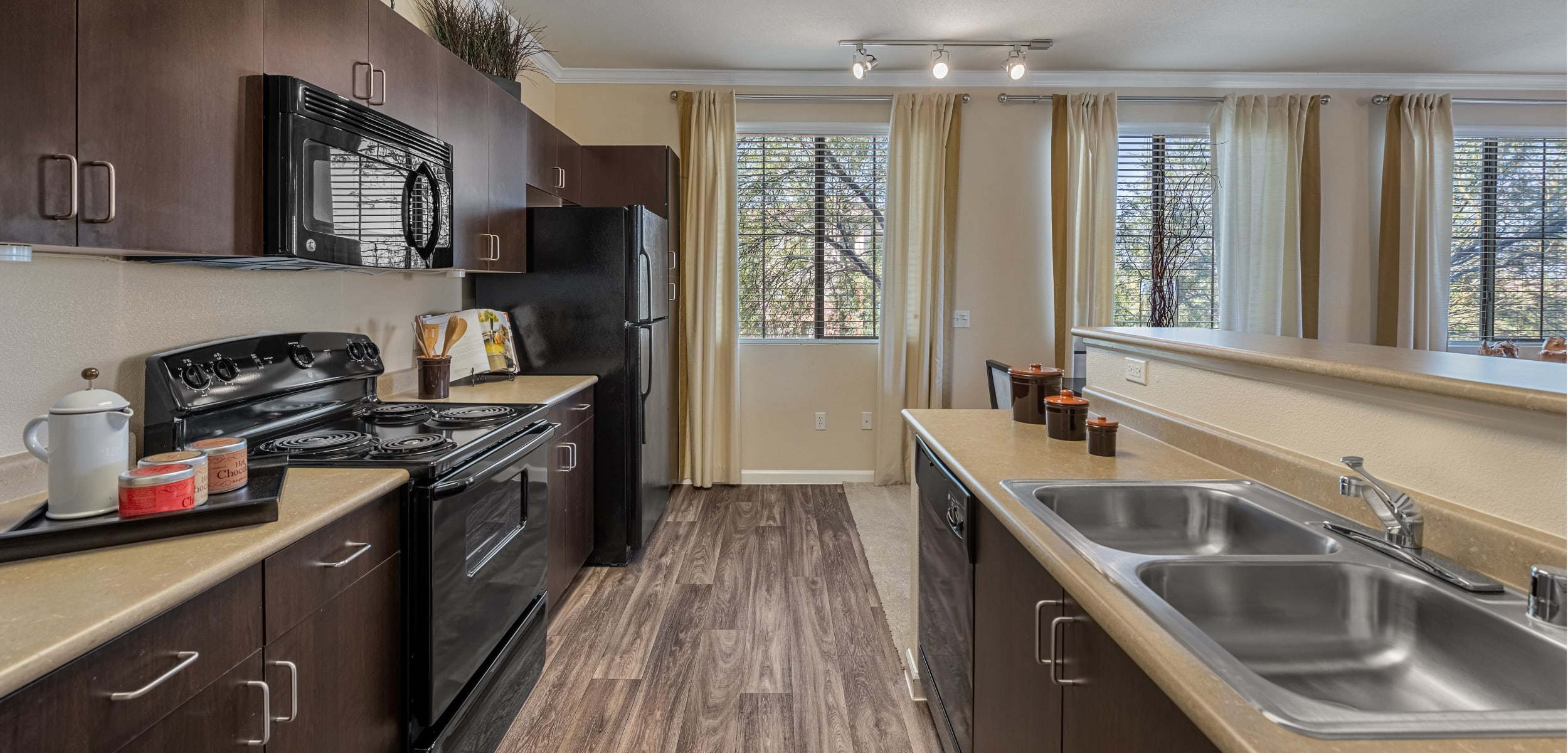 Bright and open kitchen with wood flooring at Marquis at Sonoran Preserve in Phoenix, Arizona