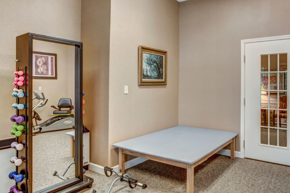 Fully equipment gym with machines and weight set at Carriage Court of Lancaster in Lancaster, Ohio