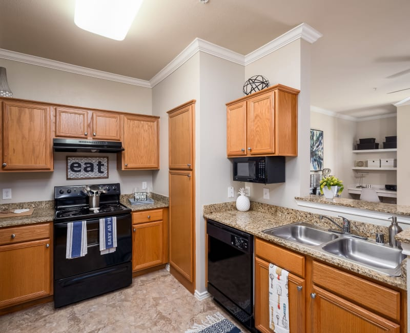 Spacious and modern kitchen with ample storage in a model home at Vail Quarters in Dallas, Texas