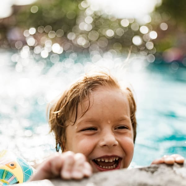 Happy child in the swimming pool at Olympus on Broadway in Carrollton, Texas