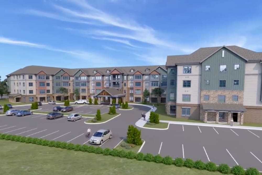 A rendering of the parking lot and exterior of Harmony at Greensboro in Greensboro, North Carolina