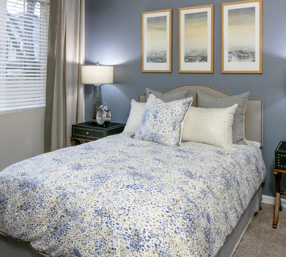 Master bedroom with a large window for natural lighting at Cortland Village Apartment Homes in Hillsboro, Oregon