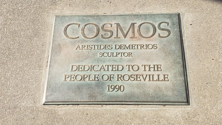 Cosmos Statue Plaque