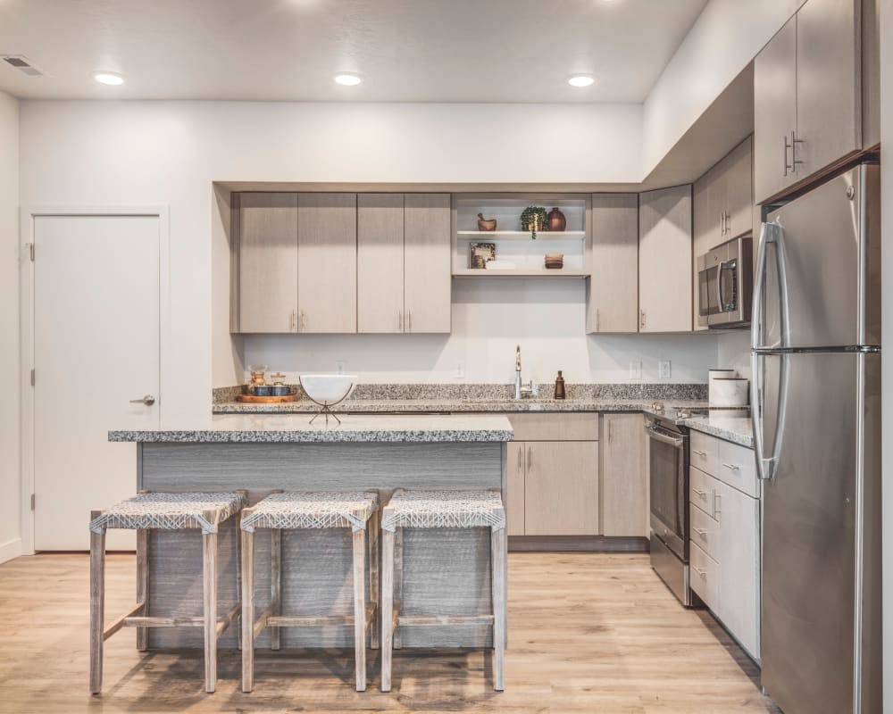 Modern kitchen with a breakfast bar for three at Hawthorne Townhomes in South Salt Lake, Utah