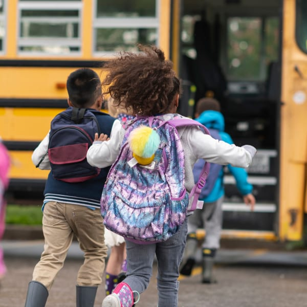 Kids loading the school bus at The Manchester Apartments in Euless, Texas