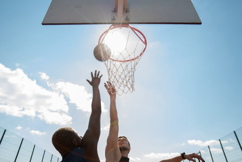 Residents playing basket ball at City Line Apartments in Newport News, Virginia