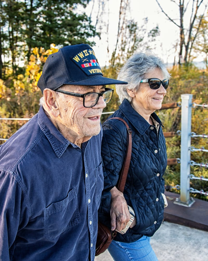 Resident walking with their partner at Randall Residence of Decatur in Decatur, Illinois