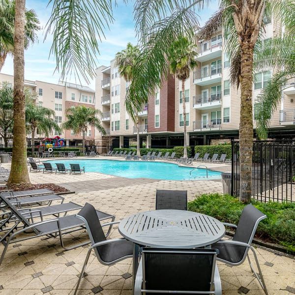 Resident swimming in the pool at The Marquis Apartment Homes in New Orleans, Louisiana