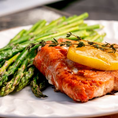Grilled salmon and asparagus, with a lemon garnish plate at Aurora on France in Edina, Minnesota