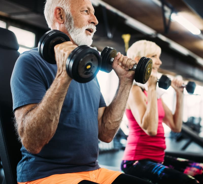 Residents staying in shape in the fitness center at Overlook Point Apartments in Salt Lake City, Utah