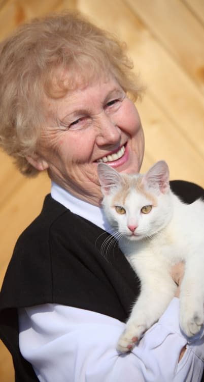 Happy resident with cat at the senior living community in Petaluma