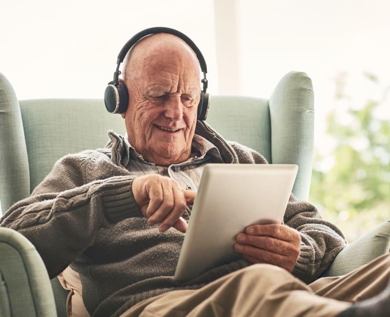 A resident listening to a program at Aurora on France in Edina, Minnesota.