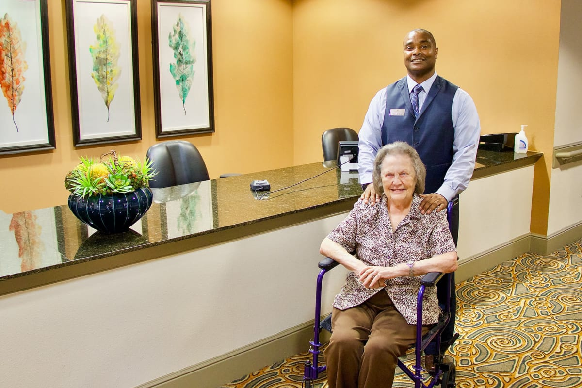 Resident being assisted by staff member at Isle at Watercrest Bryan in Bryan, Texas